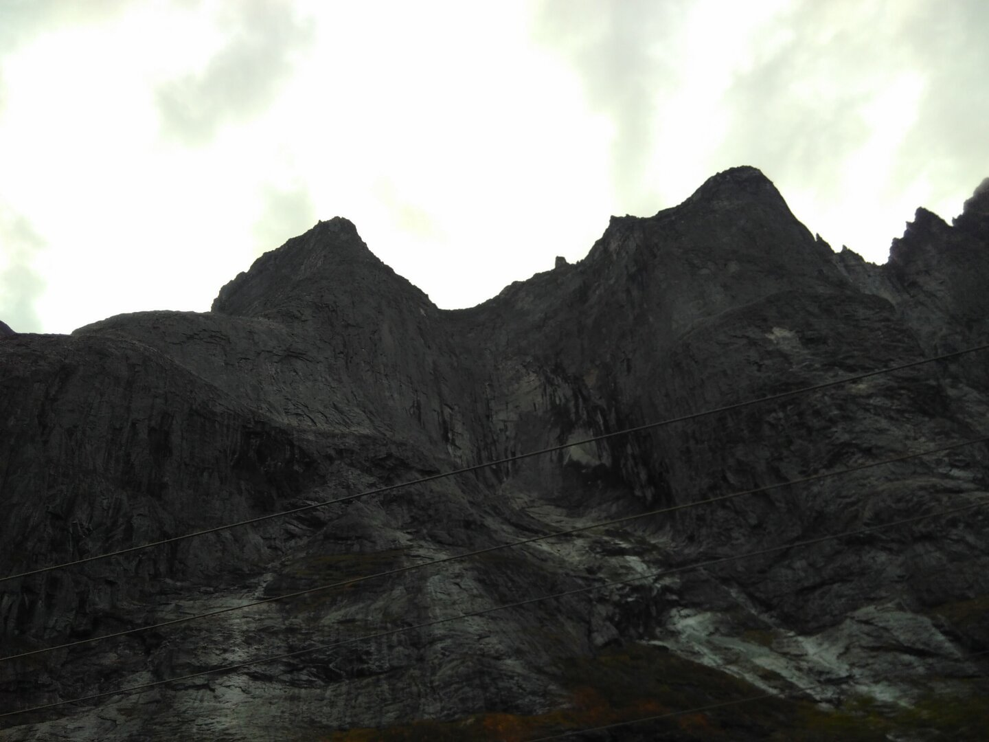 Looming mountains above